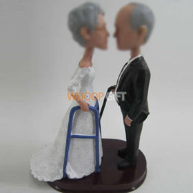 custom bobble head of wedding cake