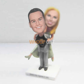 custom superman wedding cake bobbleheads