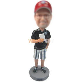 custom man in a baseball cap with cellphone in hand bobbleheads