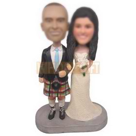 wedding cake topper groom wearing Scottish kilt bride in white dress