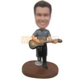 long face boy playing the guitar sitting on the chair custom bobbleheads