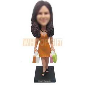 slim woman in yellow dress handing with multi bags custom bobbleheads