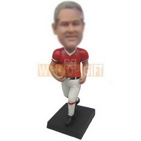 man in red sports T-shirt holding a football custom bobbleheads