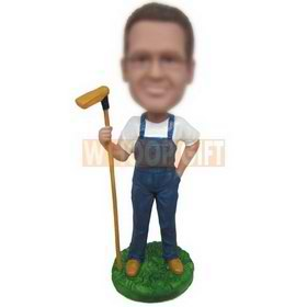 man in jeans handing up with a hoe custom bobbleheads