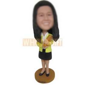 female teacher in yellow coat matching with black dress holding book custom bobbleheads