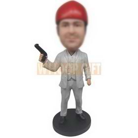man in suit wearing a red cap holding a gun custom bobbleheads