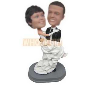 groom in black suit holding bride in white wedding dress custom bobbleheads
