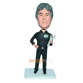 man in black work clothes handing a spanner bobblehead