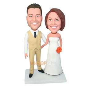 groom in beige suit and bride in white wedding dress bobblehead
