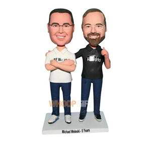 son in white shirt and father in black shirt bobblehead