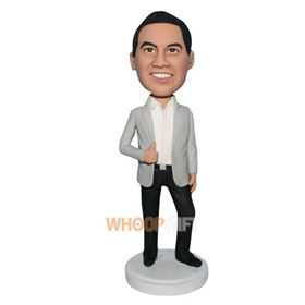 handsome man in beige suit coat matching with black pants bobblehead