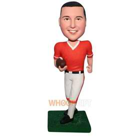 man in sports wear handing with a football bobblehead