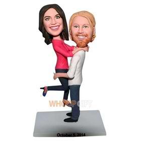 husband in white T-shirt carrying his wife in rose T-shirt bobblehead
