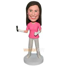 female doctor handing a operating forceps bobblehead