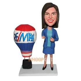 woman in blue suit with fire balloon bobblehead