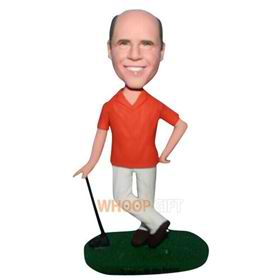 man in orange shirt playing golf bobblehead