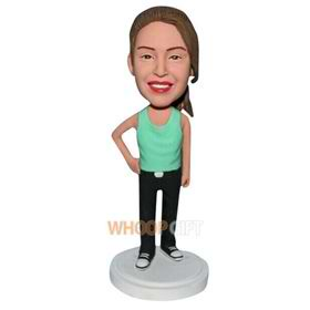 young girl in green vest bobblehead