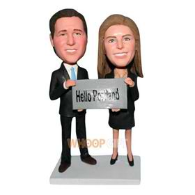 wife and husband say hello to Portland bobblehead