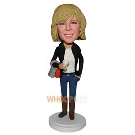 slim woman in black coat handing a bag custom bobblehead