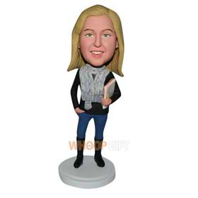 fashion lady in black T-shirt handing with a book bobblehead