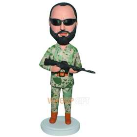 soldier in battle fatigues handing a gun custom bobblehead