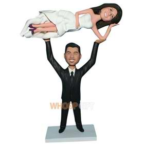 groom in black suit lifting his bride in white wedding dress custom bobblehead