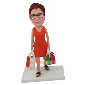 the woman dressed in a red dress bought four bags of goods bobbleheads